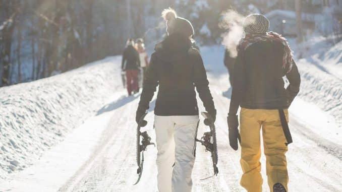 2 skiers walking