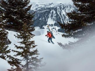 skier in red jacket