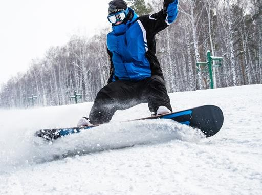 man on board in snow