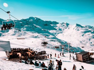 skiers by ski lifts