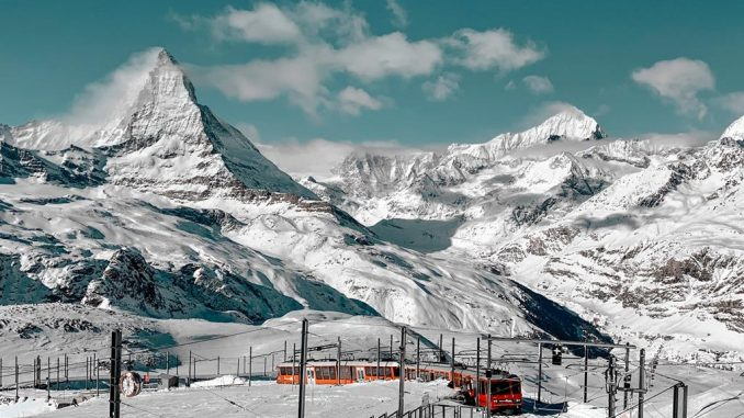 train and snowy mountains