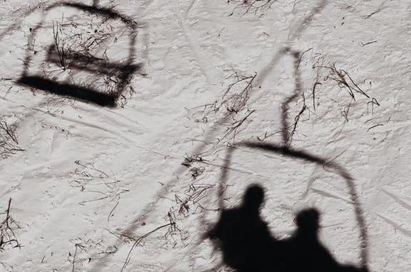 shadow of 2 people on ski lift