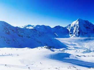 snowy mountains with skis